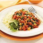 Tomato Spinach Chickpea Simmer  Healthy, quick supper!  They also recommend serving with Tilapia.  Yum!
