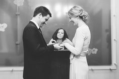 Bride and groom exchanging rings during their New York City Hall wedding, captured by NYC wedding photographer Ben Lau.
