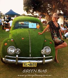 Grass covered VW Beetle