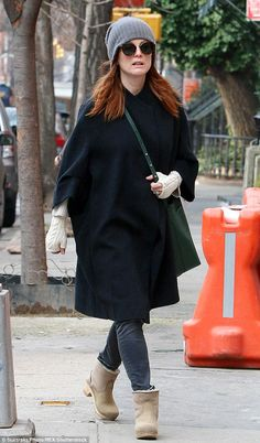 Wrapped up: Julianne Moore came back from the school run in the cold on Friday morning in ...