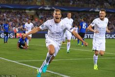 Marc Albrighton wheels away in celebration after giving Leicester a fifth-minute lead against Club Bruges