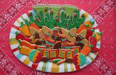 Oh yes, I'll have one of those margaritas!  Love the fiesta cactus, chilli, donkey, coyote and sombrero cookies!