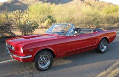 classic red Ford Mustang convertible
