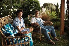 <strong>ISLAND OASIS </strong>| Stockdale and Newson, sitting on Josef Frank Svenskt Tenn rattan garden furniture, at their home in Ithaca. She wears a Loewe cotton shirt, <em>$1,790, Barneys New York.</em>