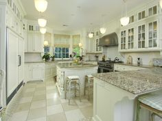 Love the happy feeling this kitchen exudes and can you say counter space!