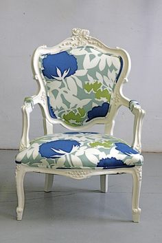 Reapolstered Louis armchair. I like the white and the fabric to go with it. Very cheery and beautiful! I would see about raising it up a little. Unless it was a genuine antique Loius chair, then I'd leave it alone and be the proud owner of a short chair!