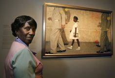 Ruby Nell Bridges and the painting Norman Rockwell made of her first day walking to William Frantz School with US Marshalls.