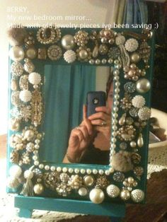 A mirror decorated with old costume jewelry stefanieisqueen