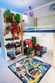 This is a shared kid's room, divided by a bookshelf, but the most creative thing is that the back of the bookshelf is pegboard for toy storage! Great to hang clothes and hats on too.