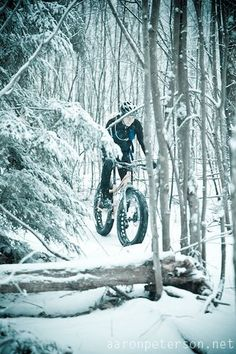 Fat bike snow bike riding on snowy single track in Marquette Michigan. To rent snow bikes visit http://www.sportsrackmqt.... Photograph thanks to Aaron Peterson Photography. #fatbike #bicycle