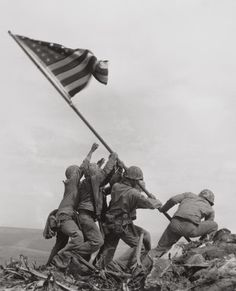 JOE ROSENTHAL (American, b. 1911)  Raising the Flag on Mt. Suribachi, Iwo Jima, 1945