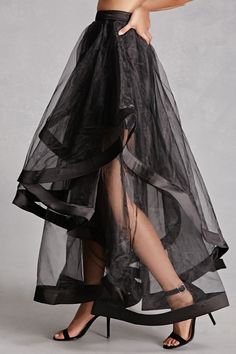 A woven maxi skirt featuring sheer flounce layers with satin trim, a satin mini underlayer, and a hidden back zipper. This is an independent brand and not a Forever 21 branded item.