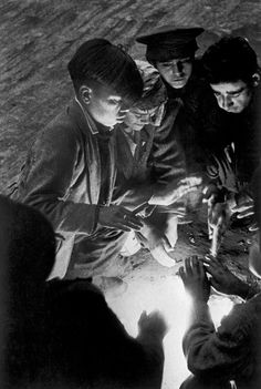 Sergio Larrain -  Santiago. 1955. In Santiago there is a vast population of vagabond children who beg in the parks, sleep anywhere they can, forming an independant sort of tribe in the middle of the city with their own language, customs, etc.