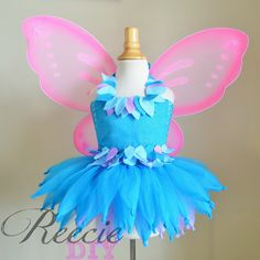 This adorable tutu dress is perfect foryour little girls upcoming photo shoot, birthday, or costume party! *Wings not included!* This dress fits sizes 2T to 5T