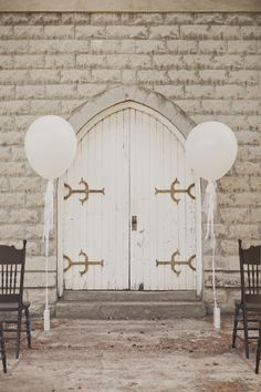 white balloons and vintage door backdrop