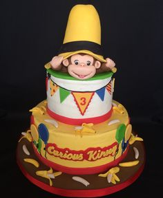 Curious George - Buttercream cake, fondant and gumpaste decorations. The hat…