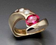 14ky gold ring with Malawi Ruby oval and Diamonds