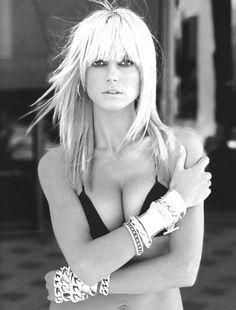 Heidi Klum. Love the cuffs. Some photos deserve two pins