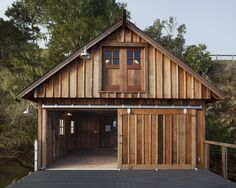 eclectic exterior by Barn Light Electric Company Pole Barn Garage, Boat Garage, Garage Shed, Garage Plans, Garage Workshop, Boat Shed, Contemporary Interior Doors, Barn Light Electric, Barn Shop