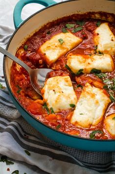 Halloumi and white beans baked in a rich, smoky, Spanish inspired tomato sauce! This is a simple but stunning one pot vegetarian meal that is on the table in just 30 minutes With lots of different serving suggestions, you will never tire of making t - f Veggie Dishes, Veggie Recipes, Cooking Recipes, Healthy Recipes, Veggie Bake, Dinner Recipes, Veggie Food, Vegetable Bake, Tomato Vegetable