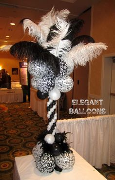 they used a group of 4 balloons and a black feather boa as a centerpiece. inexpensive and elegant