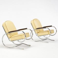 BATISTIN SPADE    lounge chairs, pair    France, c. 1935  chrome-plated steel, leather, mahogany  23.5 w x 30.5 d x 29.5 h inches