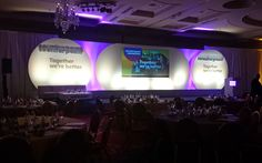 Cool stage design and lighting for an awards dinner event.
