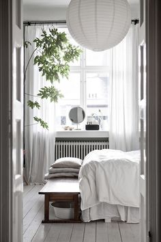 Sunny morning in the bedroom of an elegant Malmö home