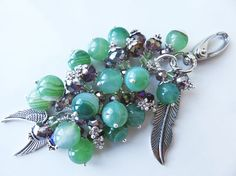 Check out this item in my Etsy shop https://www.etsy.com/uk/listing/484248419/green-bag-charm-green-and-purple-gem