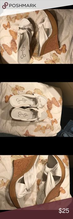 White wedge Jessica Simpson sandals White wedge Jessica Simpson sandals. Great condition. Worn a handful of times. Great for summer. Jessica Simpson Shoes Sandals