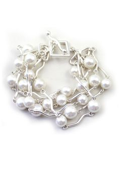 Silver with Pearls! Perfect bracelet to dressed up for a special occasion or to wear casually with your favorite jean jacket!