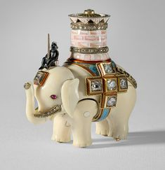 How a tiny Faberge elephant seized by the Bolsheviks ended up at Buckingham Palace  For 80 years a clockwork elephant designed by the famous House of Faberge stood forgotten in a cabinet at Buckingham Palace, until now