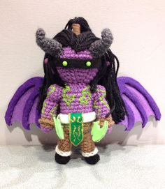 Amigurumi Illidan Stormrage     This is a custom design I made as a birthday present for a friend that loves World of Warcraft! This was one of the most extensive ami's I've made to date! I used a lot of different techniques on this little one, with some new ones to use on future creations!    His wings were a challenge but I'm thrilled with how they came out. They're actually made from sculpted wire with felt glued around it for stability. This was also one of my first ami's with long hair…
