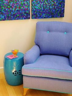 The colors are tied together by the painting.  I love the purple chair with turquoise drum table.