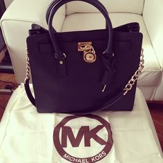 huge obsession with this purse. cute with MK logo wristlet wallet in white/cream color. Michael Kors