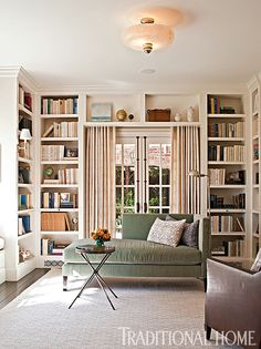 What was originally the dining room was transformed into a sunny library retreat. - Photo: Michael Garland / Design: Chris Barrett