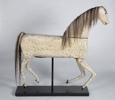 Remarkable carved and painted folk art horse at www.donolsonantiques.com