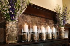 Really like the symmetry of this for the mantle in the bar. Assorted hues of purple and white stock and a row of pillar candles - but nix the birch and moss Vases Decor, Centerpieces, Chandeliers, Diy Home Decor, Room Decor, Elegant Flowers, First Home, My Dream Home, Pillar Candles