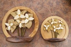 https://flic.kr/p/bEggGF | Intarsia Trilliums | Two sizes. 8 inch and 5 inch. Flowers are holly, leaves and stems are poplar.  Frame is birch and black walnut.
