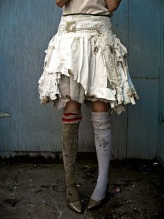 love the tattered skirt and mismatched charm of this entire look down to the knee hose leggings | GIBBOUS Fashion