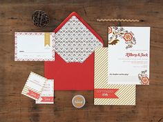 I love the gold stripes / pattern / banner / punch of coral-y red.    Magnolia Rouge: Wedding Invitations by Ruby & Willow