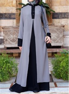 We love the juxtaposition of the loose billowing layers with the structured and posh silhouette and details of this Abaya. A perfect piece for when you want to appear professional, but not stuffy. In addition to upping the style, the added layer creates an extra-modest feel, which we know you'll love as well.Please note that the Purple Velvet and Red Mahogany colors are about 2-3cm shorter in length than the other colors.