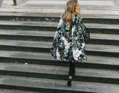 Olivia rocks the statement piece look in this floral cape.