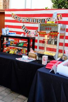Host an outdoor movie party with an amazing concession stand full of movie snacks and fun decor. Great for birthdays, showers, bachelor/bachelorette parties, or any other occasion! Get details now at fernandmaple.com!
