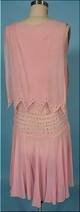 1925 Pink Chiffon and Beaded Flapper Dress with Rhinestones! I wish I could tell you that this dress is in perfect condition, but there are a few issues to mention.  Nothing of huge importance, but still, I like to sell items as perfect as possible. I've owned this dress for over 15 years (that will give you some idea of how much I love it!), but it's time to give her a new home.  She's been asking me for years... :)  So...  She's a light pink silk chiffon edged in small rhinestones at the…