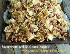 These are not your average nachos! Sauerkraut, kielbasa, and cracked pepper dijon cream makes this nacho recipe stand out from the competition.