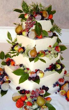 Amazing huge, four tier white buttercream wedding cake, covered with fresh fruit; green grapes, pears, apples and berries. From www.scrumptions.com   ........   #wedding #cake #birthday