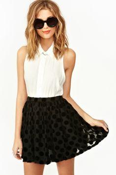 Black polka dot skirt.