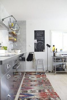Stainless steel cabinetry doors! VINTAGE RUGS IN KITCHENS   Le Souk