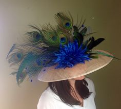 A personal favorite from my Etsy shop https://www.etsy.com/listing/272599436/peacock-and-royal-blue-derby-hat Kentucky Derby hat - peacock, Royal blue, big rim, large hat